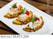 Купить «Photography of plate with sepia fried on a grill with pineapple, cherry tomatoes and sauce Chile», фото № 30811234, снято 21 августа 2019 г. (c) Яков Филимонов / Фотобанк Лори