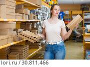 Купить «Brunette girl with gift boxes», фото № 30811466, снято 19 апреля 2017 г. (c) Яков Филимонов / Фотобанк Лори