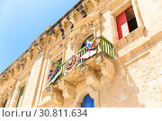 beautiful baroque building with bright doors and shutters built with sandstone (2019 год). Стоковое фото, фотограф Ирина Мойсеева / Фотобанк Лори