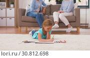 Купить «girl drawing with crayons in sketchbook at home», видеоролик № 30812698, снято 12 мая 2019 г. (c) Syda Productions / Фотобанк Лори