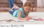 Купить «girl drawing with crayons in sketchbook at home», видеоролик № 30812718, снято 12 мая 2019 г. (c) Syda Productions / Фотобанк Лори