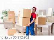 Купить «Young male contractor with boxes working indoors», фото № 30812902, снято 1 февраля 2019 г. (c) Elnur / Фотобанк Лори
