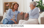 Купить «senior mother talking to adult daughter at home», видеоролик № 30813026, снято 12 мая 2019 г. (c) Syda Productions / Фотобанк Лори