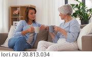 Купить «senior mother and daughter with coffee talking», видеоролик № 30813034, снято 12 мая 2019 г. (c) Syda Productions / Фотобанк Лори