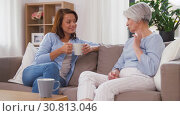 Купить «senior mother and daughter with coffee talking», видеоролик № 30813046, снято 12 мая 2019 г. (c) Syda Productions / Фотобанк Лори