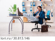 Employee coming to work straight from bed. Стоковое фото, фотограф Elnur / Фотобанк Лори