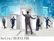 Купить «Businessman in uncertainty concept with many doors», фото № 30813186, снято 18 июня 2019 г. (c) Elnur / Фотобанк Лори