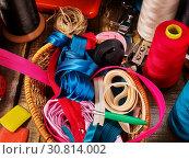Купить «Sewing accessories coil threads and bias tape in basket supplies», фото № 30814002, снято 19 мая 2019 г. (c) Gennadiy Poznyakov / Фотобанк Лори