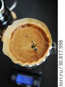 Купить «Alternative filter black coffee brew with pink origami dripper. Electronic timer scale. Specialty concept», фото № 30817998, снято 14 мая 2019 г. (c) Кристина Сорокина / Фотобанк Лори
