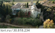 Купить «View from drone of ancient Romanesque monastery Sant Benet de Bagess, Catalonia, Spain», видеоролик № 30818234, снято 24 декабря 2018 г. (c) Яков Филимонов / Фотобанк Лори