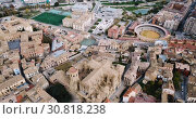Купить «Urban view from drone of roofs of residential buildings in Spanish city of Huesca», видеоролик № 30818238, снято 24 декабря 2018 г. (c) Яков Филимонов / Фотобанк Лори