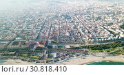 Купить «Aerial panoramic view of modern Barcelona cityscape on Mediterranean coast, Spain», видеоролик № 30818410, снято 3 ноября 2018 г. (c) Яков Филимонов / Фотобанк Лори