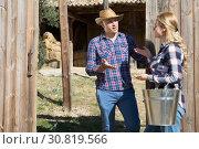 Купить «Male farmer talking to female neighbor», фото № 30819566, снято 17 октября 2019 г. (c) Яков Филимонов / Фотобанк Лори
