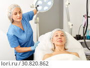 Купить «Elderly woman in aesthetic cosmetology clinic», фото № 30820862, снято 14 марта 2019 г. (c) Яков Филимонов / Фотобанк Лори
