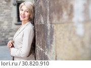 Купить «Adult woman is posing in time wallking», фото № 30820910, снято 3 сентября 2017 г. (c) Яков Филимонов / Фотобанк Лори