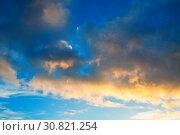 Купить «Sunset colorful sky background - orange and blue dramatic colorful clouds lit by evening sunshine», фото № 30821254, снято 21 ноября 2018 г. (c) Зезелина Марина / Фотобанк Лори