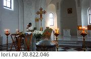 Купить «The priest performs a sacred rite in the church», видеоролик № 30822046, снято 12 ноября 2017 г. (c) Aleksandr Sulimov / Фотобанк Лори