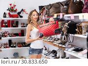 Купить «Woman choosing new handbag», фото № 30833650, снято 17 августа 2017 г. (c) Яков Филимонов / Фотобанк Лори