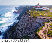 Купить «Cabo da Roca Lighthouse. Portuguese Farol de Cabo da Roca is most westerly European extent», фото № 30833894, снято 21 апреля 2019 г. (c) Яков Филимонов / Фотобанк Лори