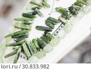 Womens jewelry from aventurine stone in a jewelry store. Стоковое фото, фотограф Яков Филимонов / Фотобанк Лори