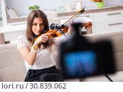 Купить «Female beautiful blogger playing violin», фото № 30839062, снято 1 октября 2018 г. (c) Elnur / Фотобанк Лори