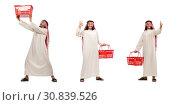Купить «Arab man doing shopping isolated on white», фото № 30839526, снято 11 июня 2015 г. (c) Elnur / Фотобанк Лори