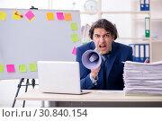 Купить «Young male employee unhappy with excessive work», фото № 30840154, снято 1 марта 2019 г. (c) Elnur / Фотобанк Лори
