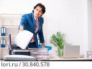 Купить «Young employee making copies at copying machine», фото № 30840578, снято 14 декабря 2018 г. (c) Elnur / Фотобанк Лори