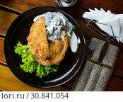 Купить «Schnitzel with mushrooms», фото № 30841054, снято 26 июня 2019 г. (c) Яков Филимонов / Фотобанк Лори