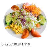 Купить «Mix salad with vegetables, boiled carrot, corn and lettuce at plate», фото № 30841110, снято 15 ноября 2019 г. (c) Яков Филимонов / Фотобанк Лори