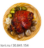 Купить «Oven baked pork knuckle with boiled onions and pickled cucumbers», фото № 30841154, снято 22 июля 2019 г. (c) Яков Филимонов / Фотобанк Лори