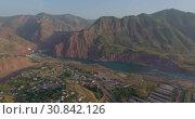 Купить «Город Нурек, плотина, водохранилище. Вид с дрона. Таджикистан», видеоролик № 30842126, снято 3 июня 2016 г. (c) kinocopter / Фотобанк Лори