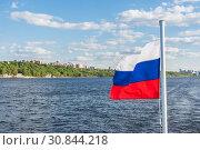 Купить «Russian flag on the background of the Volga River and the city of Samara», фото № 30844218, снято 21 мая 2019 г. (c) Дмитрий Тищенко / Фотобанк Лори