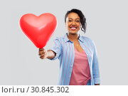 Купить «african american woman with heart-shaped balloon», фото № 30845302, снято 2 марта 2019 г. (c) Syda Productions / Фотобанк Лори