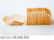 Купить «close up of white toast bread», фото № 30845502, снято 22 мая 2015 г. (c) Syda Productions / Фотобанк Лори