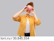 Купить «funny teenage girl with donuts instead of eyes», фото № 30845554, снято 28 февраля 2019 г. (c) Syda Productions / Фотобанк Лори