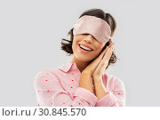 Купить «happy young woman in pajama and eye sleeping mask», фото № 30845570, снято 6 марта 2019 г. (c) Syda Productions / Фотобанк Лори