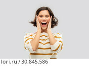 Купить «impressed woman in pullover holding to her face», фото № 30845586, снято 6 марта 2019 г. (c) Syda Productions / Фотобанк Лори