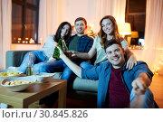 Купить «happy friends taking selfie at home party», фото № 30845826, снято 22 декабря 2018 г. (c) Syda Productions / Фотобанк Лори