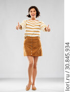 Купить «woman in pullover, skirt and shoes shows thumbs up», фото № 30845934, снято 6 марта 2019 г. (c) Syda Productions / Фотобанк Лори