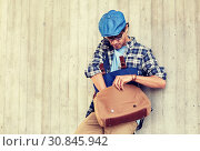 Купить «hipster man looking for something in his bag», фото № 30845942, снято 15 июня 2016 г. (c) Syda Productions / Фотобанк Лори