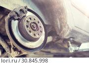 Купить «car brake disc at repair station», фото № 30845998, снято 1 июля 2016 г. (c) Syda Productions / Фотобанк Лори