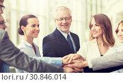 Купить «business people putting hands on top in office», фото № 30846014, снято 3 июля 2016 г. (c) Syda Productions / Фотобанк Лори