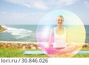 Купить «woman doing yoga in lotus pose with rainbow aura», фото № 30846026, снято 6 августа 2014 г. (c) Syda Productions / Фотобанк Лори