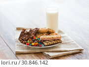 Купить «chocolate, cookies, candies and muesli bars», фото № 30846142, снято 22 мая 2015 г. (c) Syda Productions / Фотобанк Лори