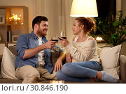 Купить «happy couple drinking red wine at home in evening», фото № 30846190, снято 5 января 2019 г. (c) Syda Productions / Фотобанк Лори