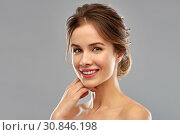 Купить «smiling young woman over grey background», фото № 30846198, снято 20 января 2019 г. (c) Syda Productions / Фотобанк Лори