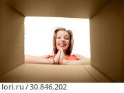 happy girl looking into open gift box. Стоковое фото, фотограф Syda Productions / Фотобанк Лори