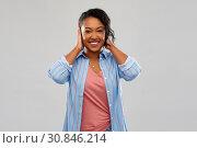 Купить «happy african american woman closing ears by hands», фото № 30846214, снято 2 марта 2019 г. (c) Syda Productions / Фотобанк Лори