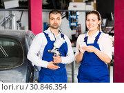 Купить «Two mechanics discussing list of works», фото № 30846354, снято 4 апреля 2018 г. (c) Яков Филимонов / Фотобанк Лори